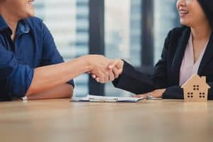 Man Shaking Hand After Applying A Legal Loan From a Legal Money Lender