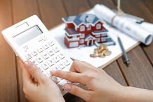Female using calculator to prepare for her mortgage